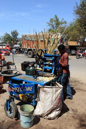 sugar cane: Sugar cane juicer Editorial