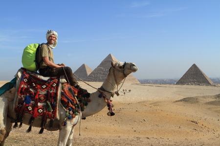camello: Los turistas en Egipto Foto de archivo