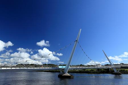 pedestrian bridges: The bridge over the River Foyle from Derry Stock Photo