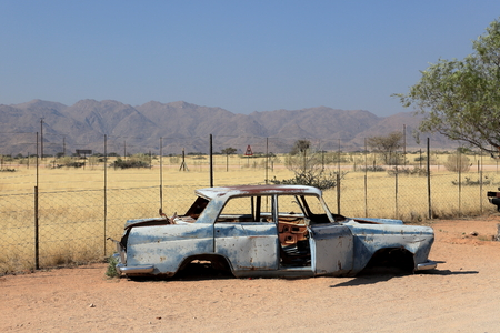 steel bucket: Scrap cars in Namibia Stock Photo
