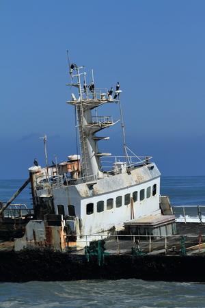 shipwreck: Capsized shipwreck on the Skeleton Coast in Namibia