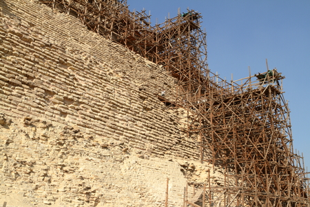 egypt pyramid: Scaffolding at the Step Pyramid of Saqqara in Egypt Stock Photo
