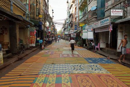 prayer rug: Prayer rugs in the streets of Rangoon
