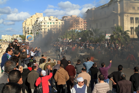 arab spring: Demonstrations and burning cars in Alexandria Egypt Editorial