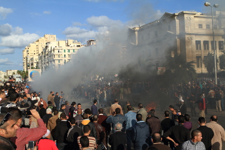 demonstrations: Demonstrations and burning cars in Alexandria Egypt Editorial