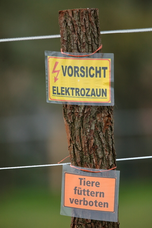 electric fence: Warning labels on an electric fence