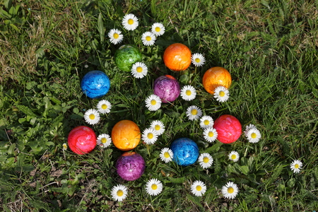 osterfest: Colorful Easter eggs in easter basket Stock Photo