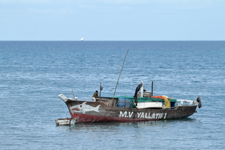 Fishing boats and sailing boats in the Indian Ocean Editorial