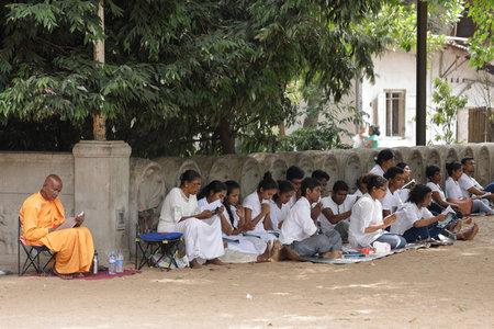 Believers under the Bodhi tree from the Kelaniya Raja Maha Vihara Temple in Colombo, 30. July 2017