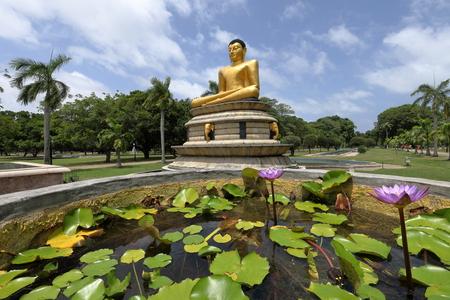 Golden Buddha in the Viharamahadevi Park of Colombo