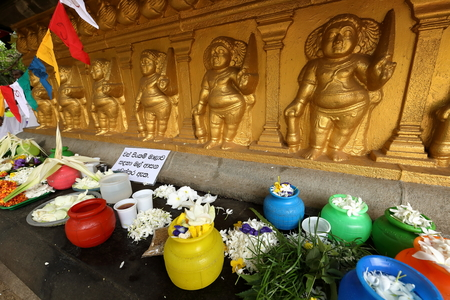 vihara: Sacrifices under the bodhi tree from the Kelaniya Raja Maha Vihara temple in Colombo