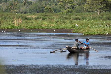 Fisherman in a boat on a lake in Sri Lanka Stock Photo