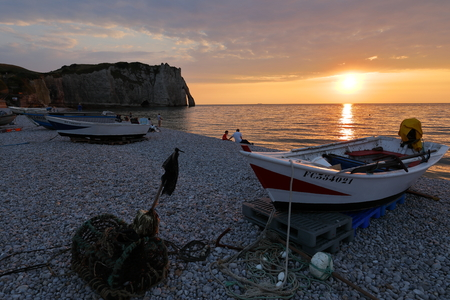 Sunset on the beach of Etretat in Normandy Фото со стока