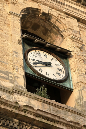 Historic church clock of Dieppe in Normandy