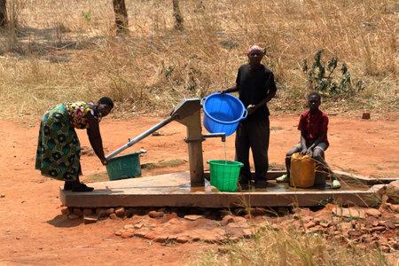 Farm People fetching water in Malawi
