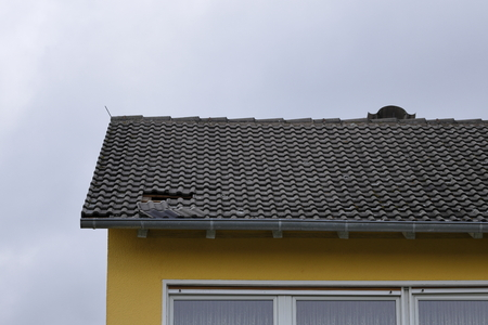 Hole in the roof by wind and storm