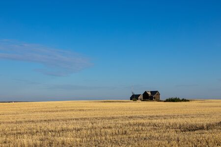 Abandoned Farm in the Prairie of Canada Stock Photo