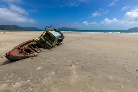 Boats Wreck on a beach of Con Dao in Vietnam