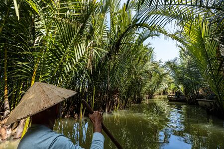 Tour at the water palm village of Hoi An in Vietnam