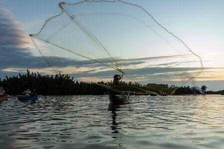 Traditional fisherman is fishing in Hoi An Vietnam Reklamní fotografie