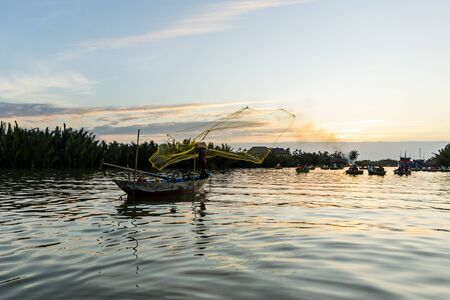 Traditional fisherman is fishing in Hoi An Vietnam