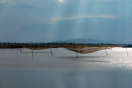 Fishing net at the Thu Bon River of Hoi An in Vietnam