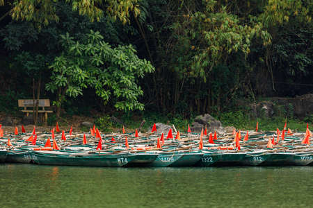The tourists rowboats of Trang An in Vietnam