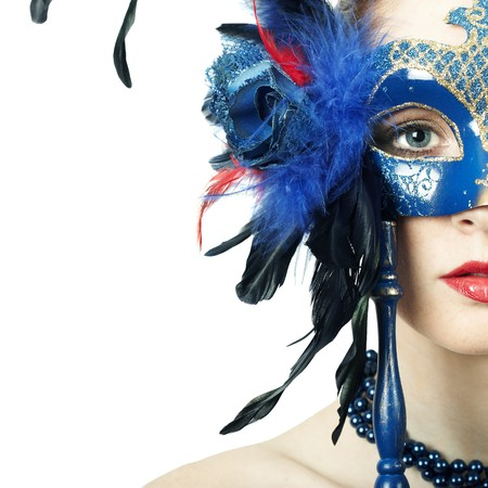 The beautiful young girl in a mysterious mask Stock Photo - 8027257