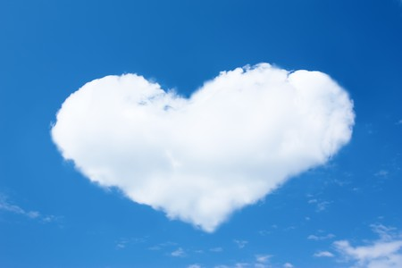 Heart from cloud in the blue sky photo