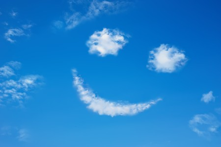 Smilie from cloud in the blue sky Stock Photo