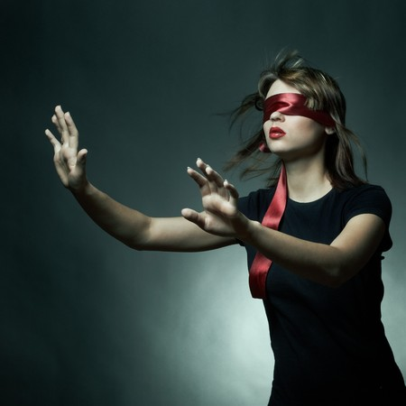 Portrait of the young woman blindfold photo