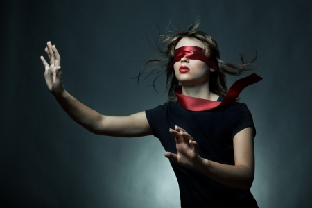 Portrait of the young woman blindfold Stock Photo - 8085255
