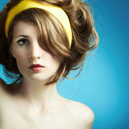 Portrait of the young woman on blue background