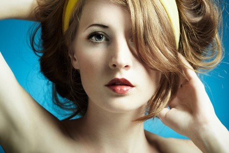 sensuality: Portrait of the young woman on blue background