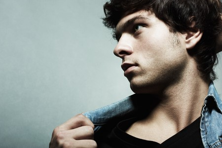 Fashion portrait of the young beautiful man photo