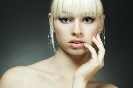 Fashion portrait of the young blonde woman Stock Photo - 9231951