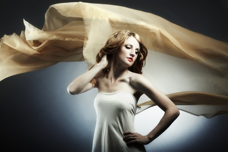 Portrait of the young woman against a flying fabric Stock Photo - 9264358