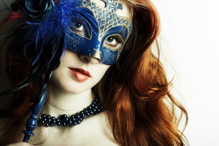 The beautiful young girl in a mysterious mask Stock Photo - 9264351