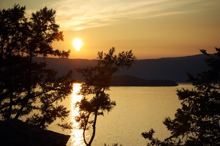 Night landscape against a decline lake Baikal photo