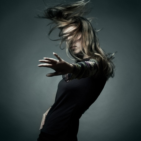 Fashion portrait of the beautiful woman with flying hair photo