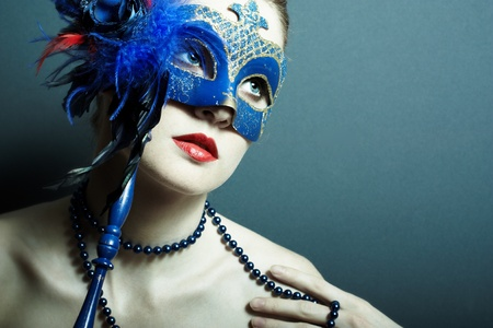 The beautiful young girl in a mysterious mask Stock Photo - 9264346