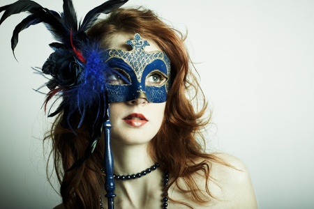 The beautiful young girl in a mysterious mask Stock Photo - 9268412