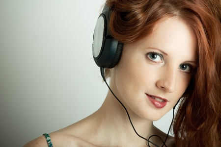 The young girl with headphones photo