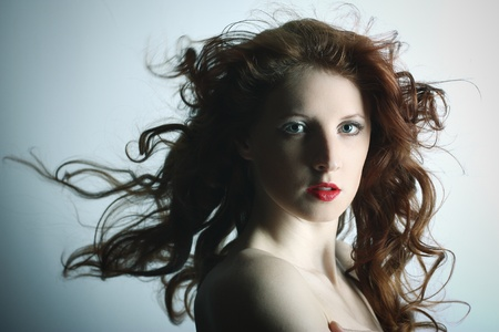 Portrait of the young sexy girl with wavy hair photo