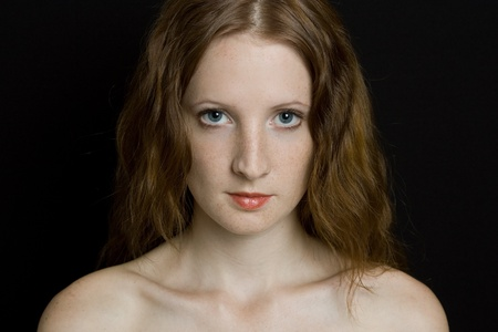 The young beautiful girl with freckles photo