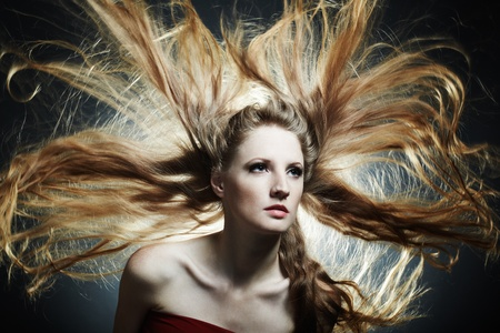 Fashion portrait of the young sexy woman with flying hair Stock Photo - 9356645