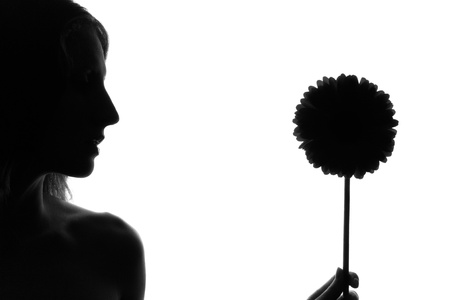 two person only: Silhouette of the woman with a flower on a white background Stock Photo