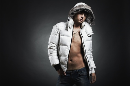 vogue: Fashion portrait of the young beautiful man in a white jacke Stock Photo