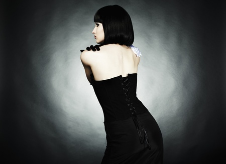 Fashion portrait of young beautiful woman in the black dress photo