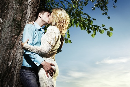 erotic couple: Portrait of love couple embracing outdoor in park